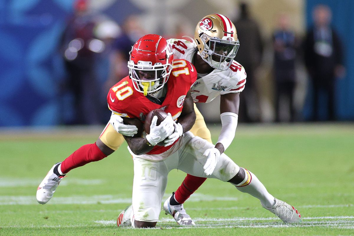 Tyreek Hill of the Kansas City Chiefs is tackled by Emmanuel Moseley of the San Francisco 49ers after a reception during the fourth quarter in Super Bowl LIV at Hard Rock Stadium on February 02, 2020 in Miami, Florida.
