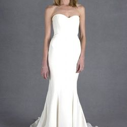 """Month 2: With morning sickness at its peak, you're living off Saltines and ginger ale. Try not to barf on Nicole Miller's <a href=""""http://www.nicolemiller.com/dakota-bridal-gown"""">Dakota Bridal Gown</a> ($1,035 )."""