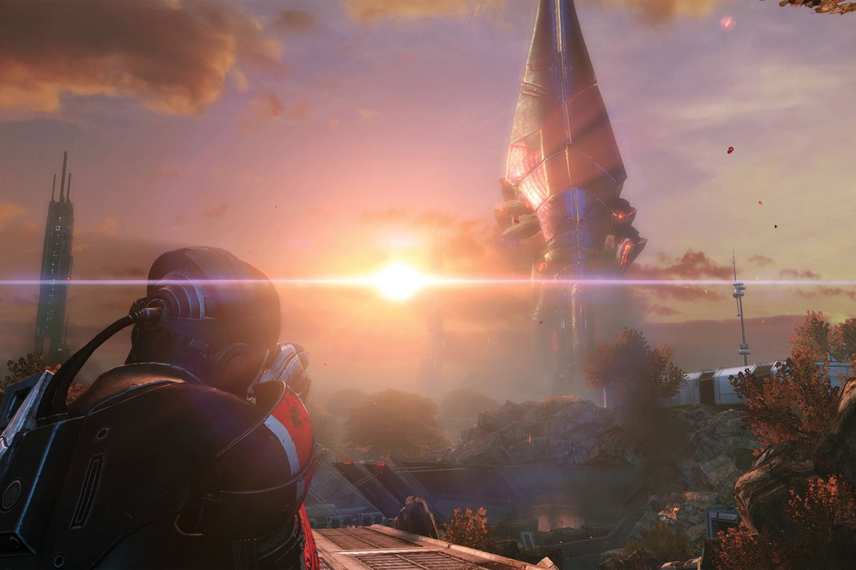 A Mass Effect character looks over a large structure with a sunset
