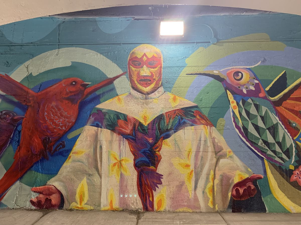 """A mural of legendary Mexican priest and professional wrestler Fray Tormenta, completed by Chicago artist CZR PRZ, who says: """"He'd wrestle at night to make money"""" for the orphanage he ran. The bird on the right was painted by Mexican artist Senkoe."""