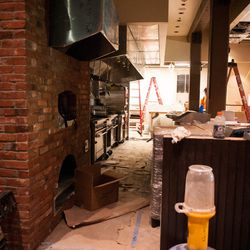 The wood-fired oven and open kitchen, which will feature a chef's counter.