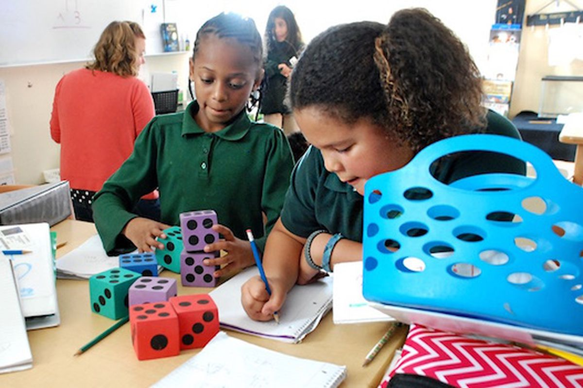 Students at the AXL Academy charter school in Aurora work on math problems in 2015. Photo by Nic Garcia