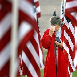Lana Barlow of Sandy walks in the Healing Field after attending a 9/11 memorial service at Sandy City Hall on Sept.11, 2003.