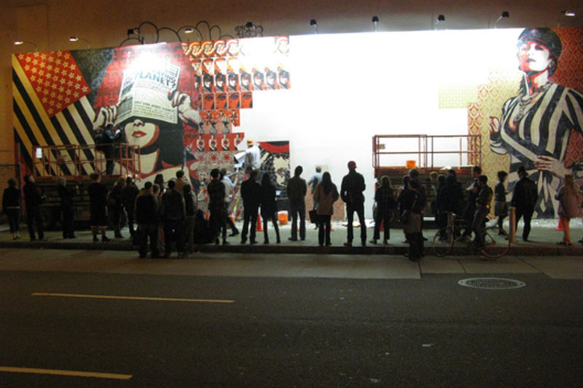 """A crowd watches the Shepard Fairey mural go up Tuesday night. <a href=""""http://www.jensnow.com/"""">Jen Snow</a>, 4/20/10"""