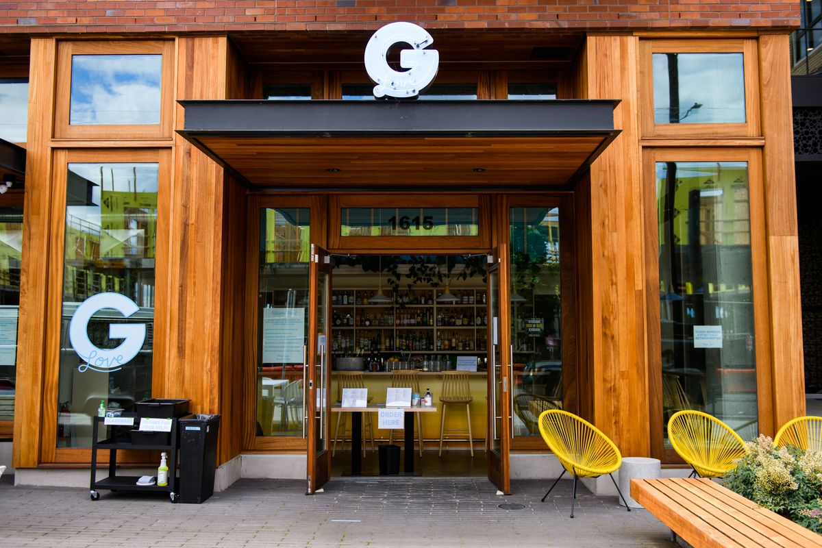 The entrance of G-Love, with a small ordering table at the front of the door