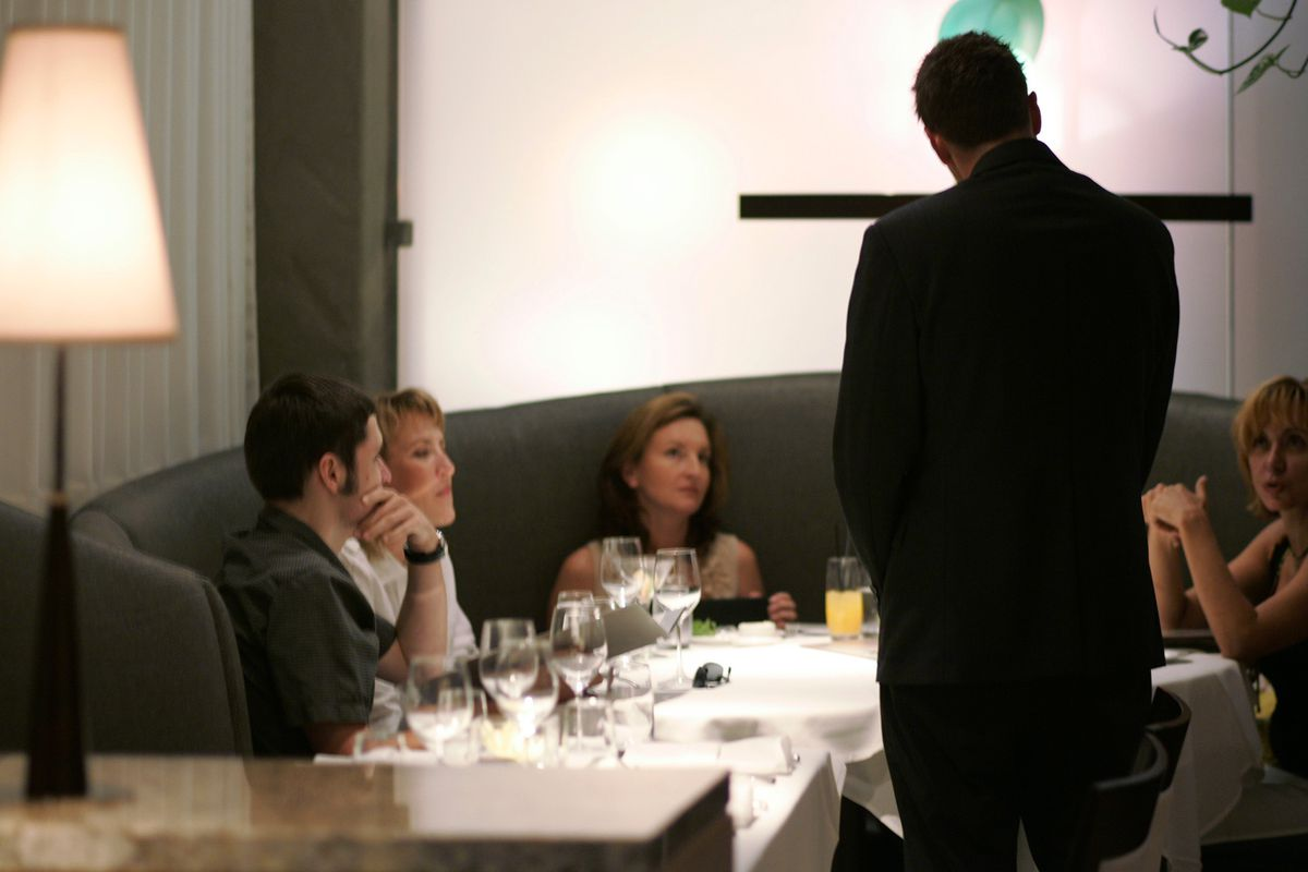 A waiter talks to patrons about the menu while in the fine dining room at Jack's restaurant in La J