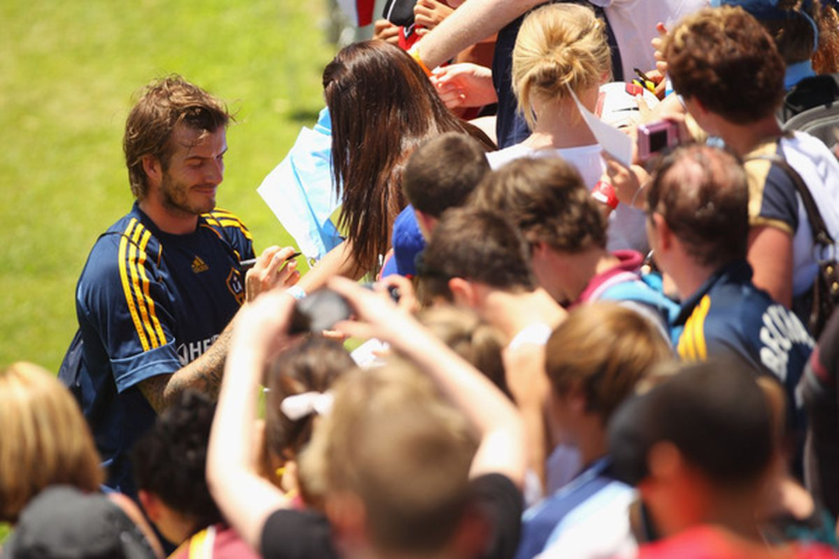 David Beckham practicing his signature for his new contract.