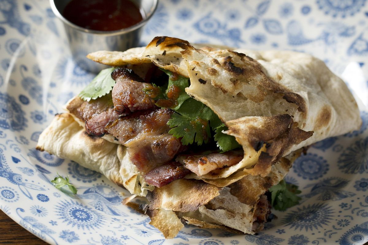 Bacon naan at Dishoom Carnaby Street in Soho — the popular Indian cafe chain will launch its first cookbook with Bloomsbury UK this year