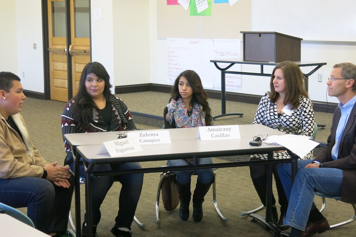 Denver schools superintendent Tom Boasberg and North High School Principal Nicole Veltze meet with three seniors—from left, Miguel Figueroa, Zulema Campos, and Amairany Casillas—to talk about graduating high school.