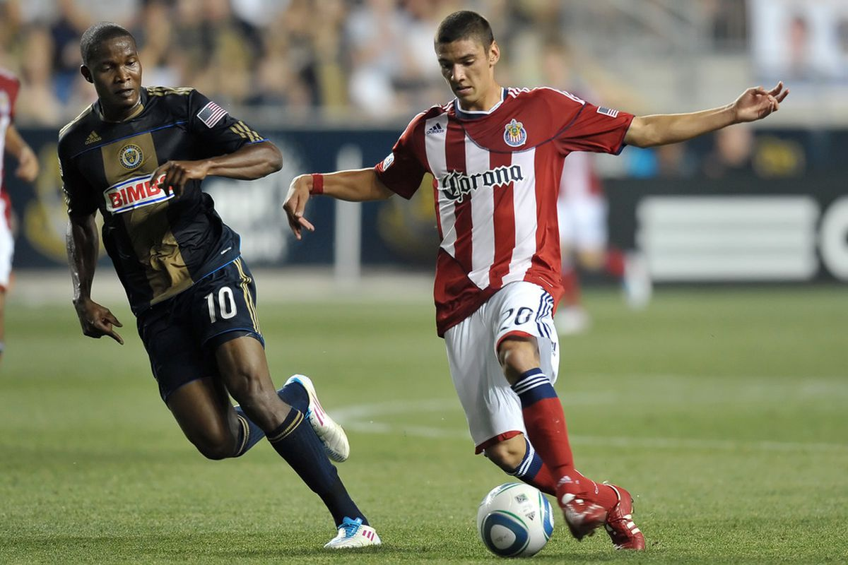 CHESTER, PA- JUNE 25: Zarek Valentin #20 of Chivas USA tries to work the ball past Danny Mwanga #10 of the Philadelphia Union at PPL Park on June 25, 2011 in Chester, Pennsylvania. The Union won 3-2. (Photo by Drew Hallowell/Getty Images)