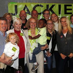 Jackie Biskupski, holding son Archie, poses for a photo while waiting for results in the Salt Lake City mayoral race during her election night party on Tuesday, Nov. 3, 2015.