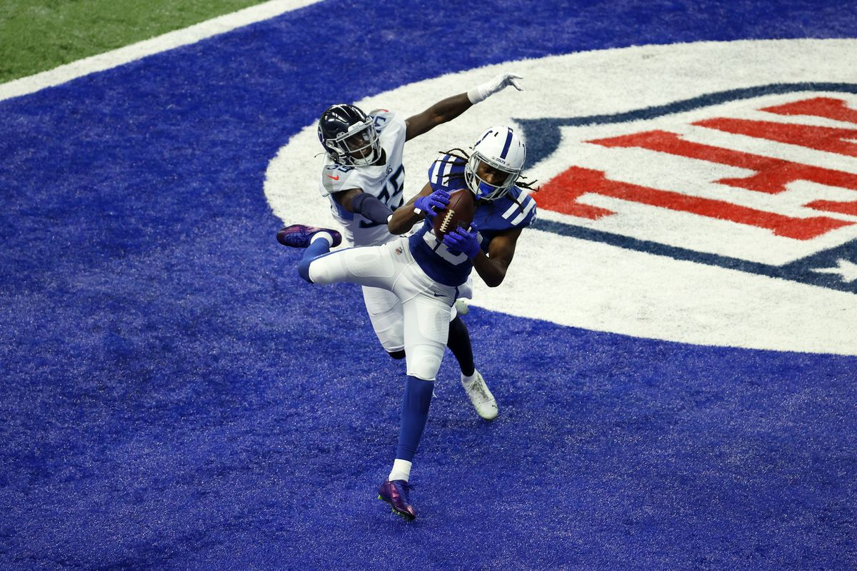 T.Y. Hilton #13 of the Indianapolis Colts catches a touchdown pass in the fourth quarter against Breon Borders #39 of the Tennessee Titans during their game at Lucas Oil Stadium on November 29, 2020 in Indianapolis, Indiana.