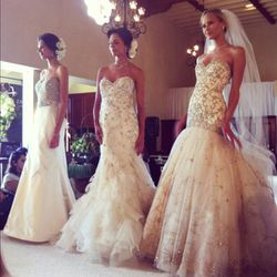 Models working gowns designed by Lazaro for JLM Couture.
