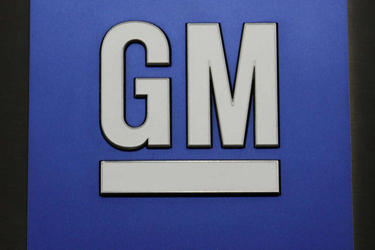 In this Jan. 25, 2010 file photo, a General Motors Co. logo is shown during a news conference in Detroit.