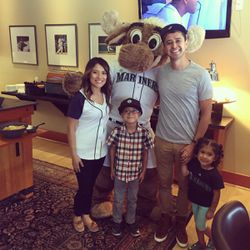 Antonio Lopez is photographed with his wife, two children and the Seattle Mariner Moose.