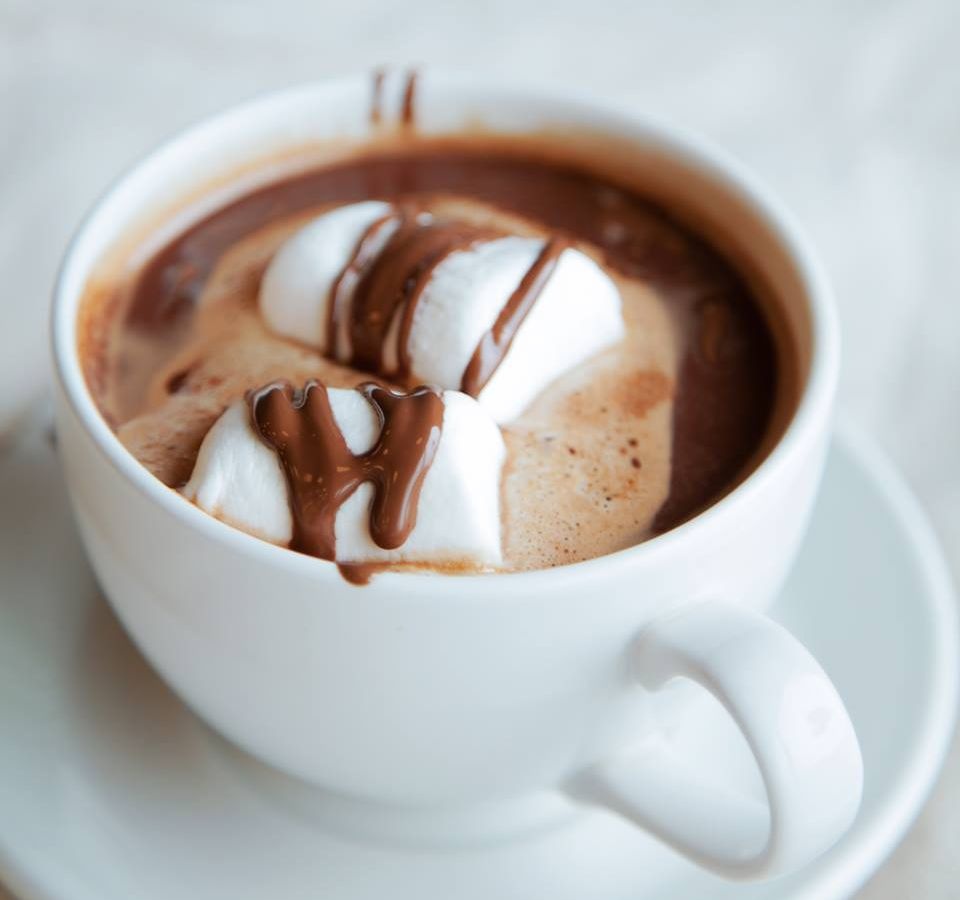 Hot chocolate with marshmallows in a white cup.