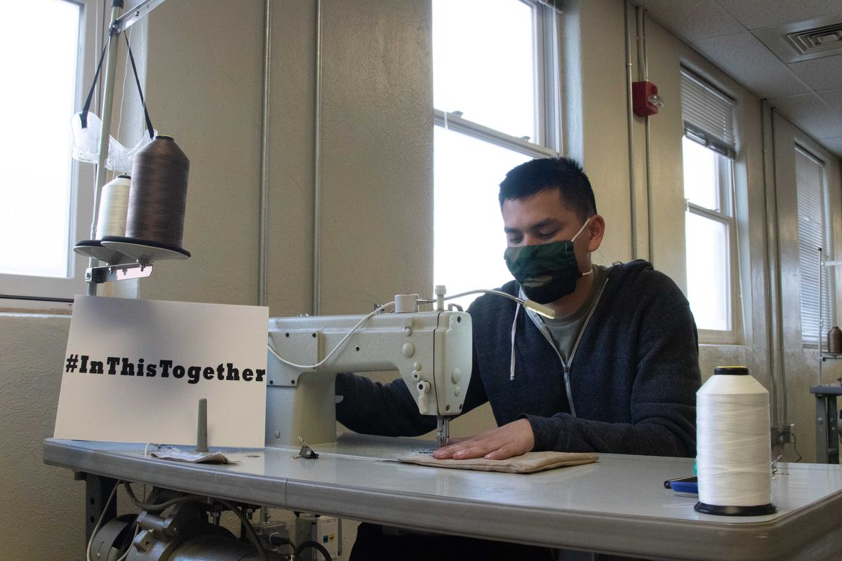 Spc. Kalani Bedell, a parachute rigger from the 19th Special Forces Group, sews together two layers of fabric to make masks to protect Utah National Guard soldiers during the COVID-19 pandemic, April 15, 2020, on Camp Williams. The masks are based on instructions from University of Florida Health, with two layers of tightly woven cotton fabric.