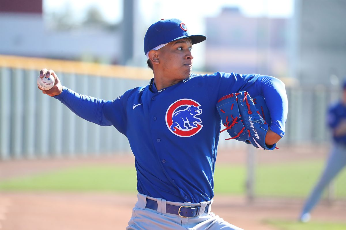 Adbert Alzolay throws during a bullpen session at the Cubs' spring training facility.