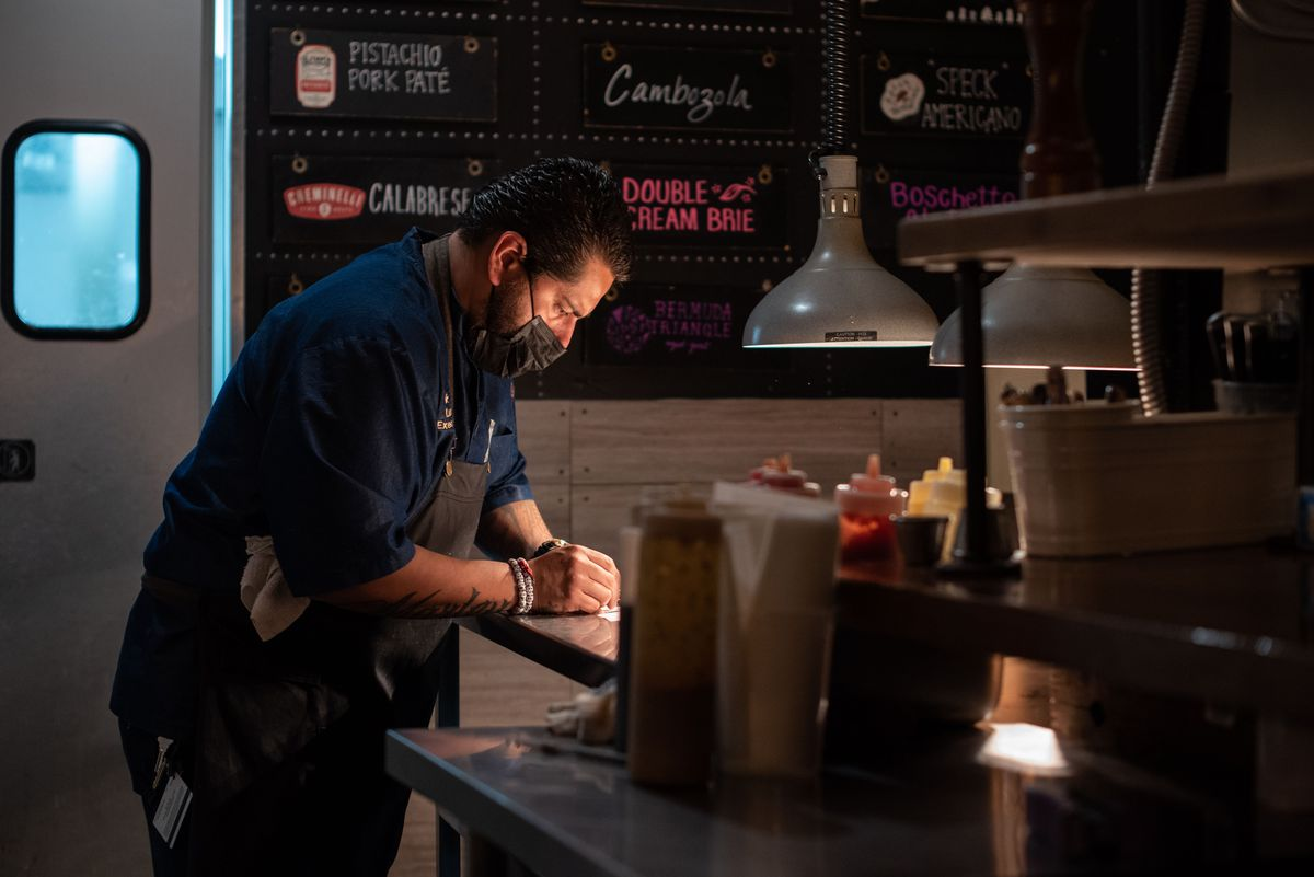 Chef handles orders at Newhall Refinery.