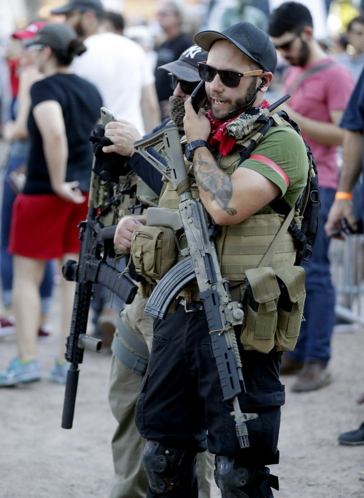 Members of the John Brown Gun Club and Redneck Revolt protest outside the Phoenix Convention Center.   Matt York/AP