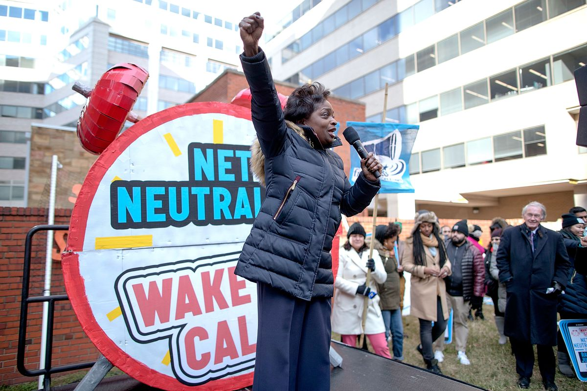 FCC Commissioner Mignon Clyburn speaks into a microphone at a net neutrality rally.