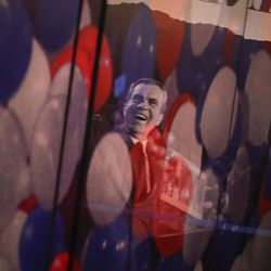 In this Wednesday, Oct. 5, 2016, photo, an image of  former President Richard Nixon from the 1972 presidential campaign is reflected on a glass window in the museum at the Richard Nixon Presidential Library and Museum in Yorba Linda, Calif. The museum will reopen Friday, Oct. 14, following a $15 million makeover aimed at bringing the country's 37th president closer to younger generations less familiar with his groundbreaking trip to China or the Watergate scandal.