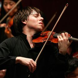 Violin virtuoso Joshua Bell was enthusiastically welcomed to Brigham Young University's de Jong Concert Hall stage and had his nearly sold-out audience hanging on every note Thursday night. Bell is pictured here from a performance in 2012.