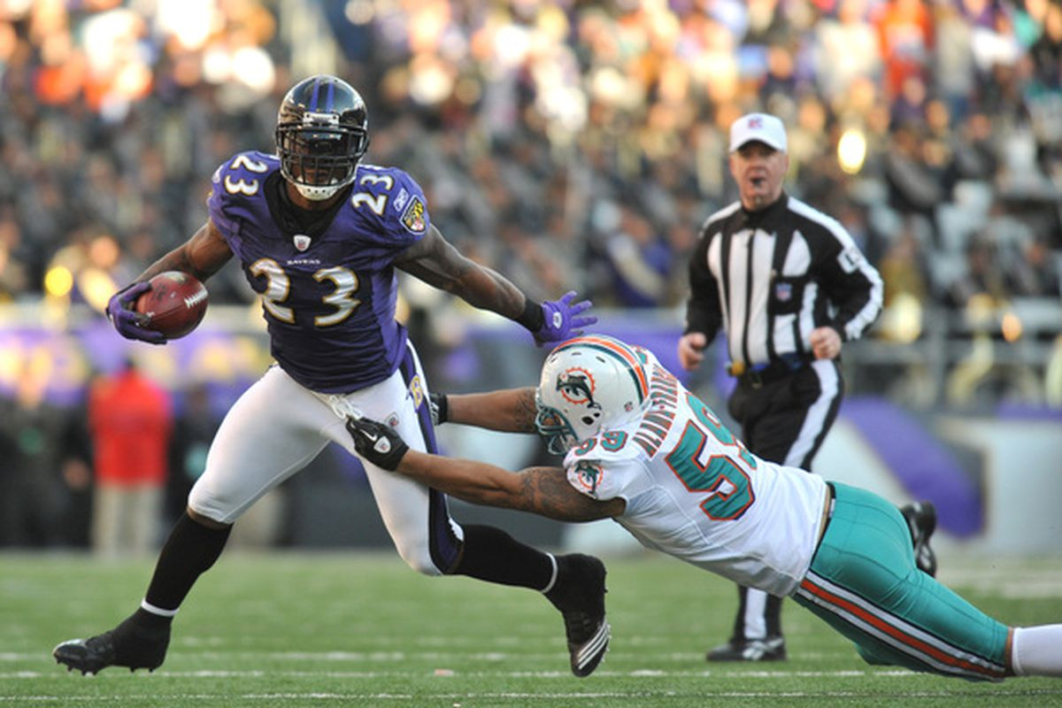 BALTIMORE MD - NOVEMBER 7:  Willis McGahee #23 of the Baltimore Ravens runs the ball against the Miami Dolphins at M&T Bank Stadium on November 7 2010 in Baltimore Maryland. The Ravens defeated the Dolphins 26-10. (Photo by Larry French/Getty Images)