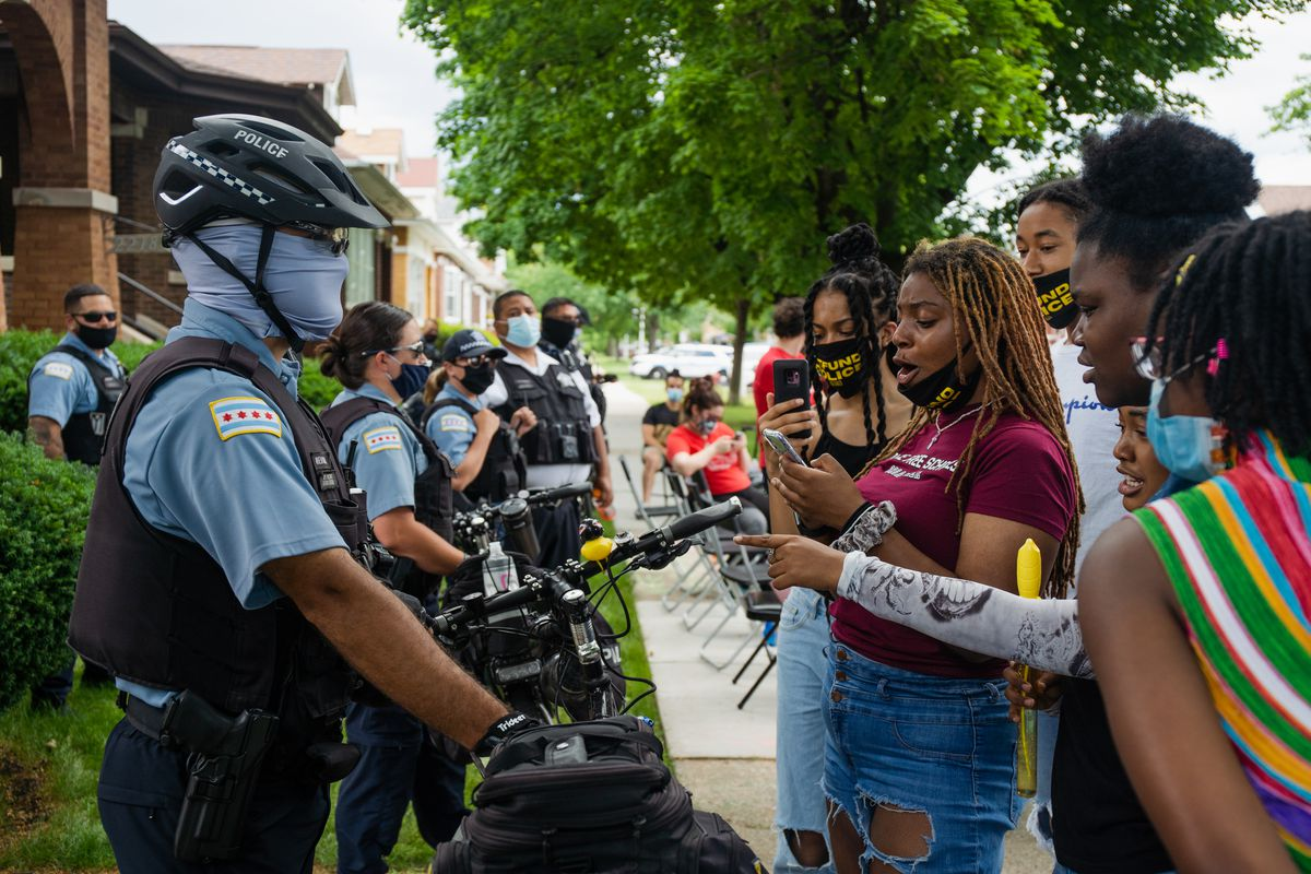 Community activists protested outside the home of Miguel del Valle, the Chicago Board of Education's president, in June as the board was voting on whether to continue its contract for police officers in schools.