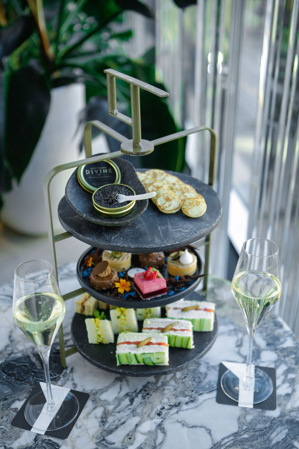 A stacked tray of afternoon tea treats.