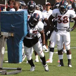 Knowshon Moreno throws his shoulder into the sled during drills