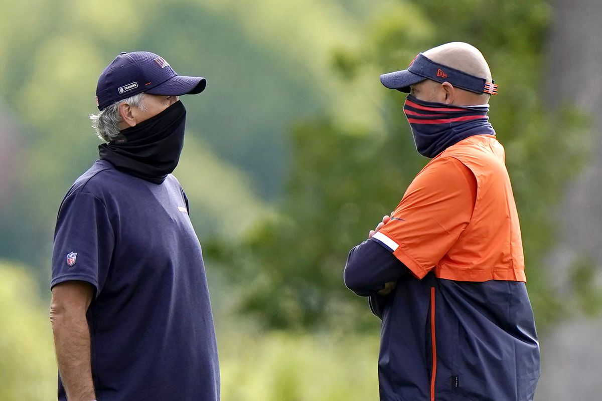 Bears coach Matt Nagy, right, and defensive coordinator Chuck Pagano talk during practice in August.