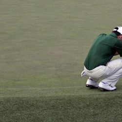 Louis Oosthuizen, of South Africa, reacts after missing a putt on the 10th hole during a sudden death playoff at the Masters golf tournament Sunday, April 8, 2012, in Augusta, Ga.