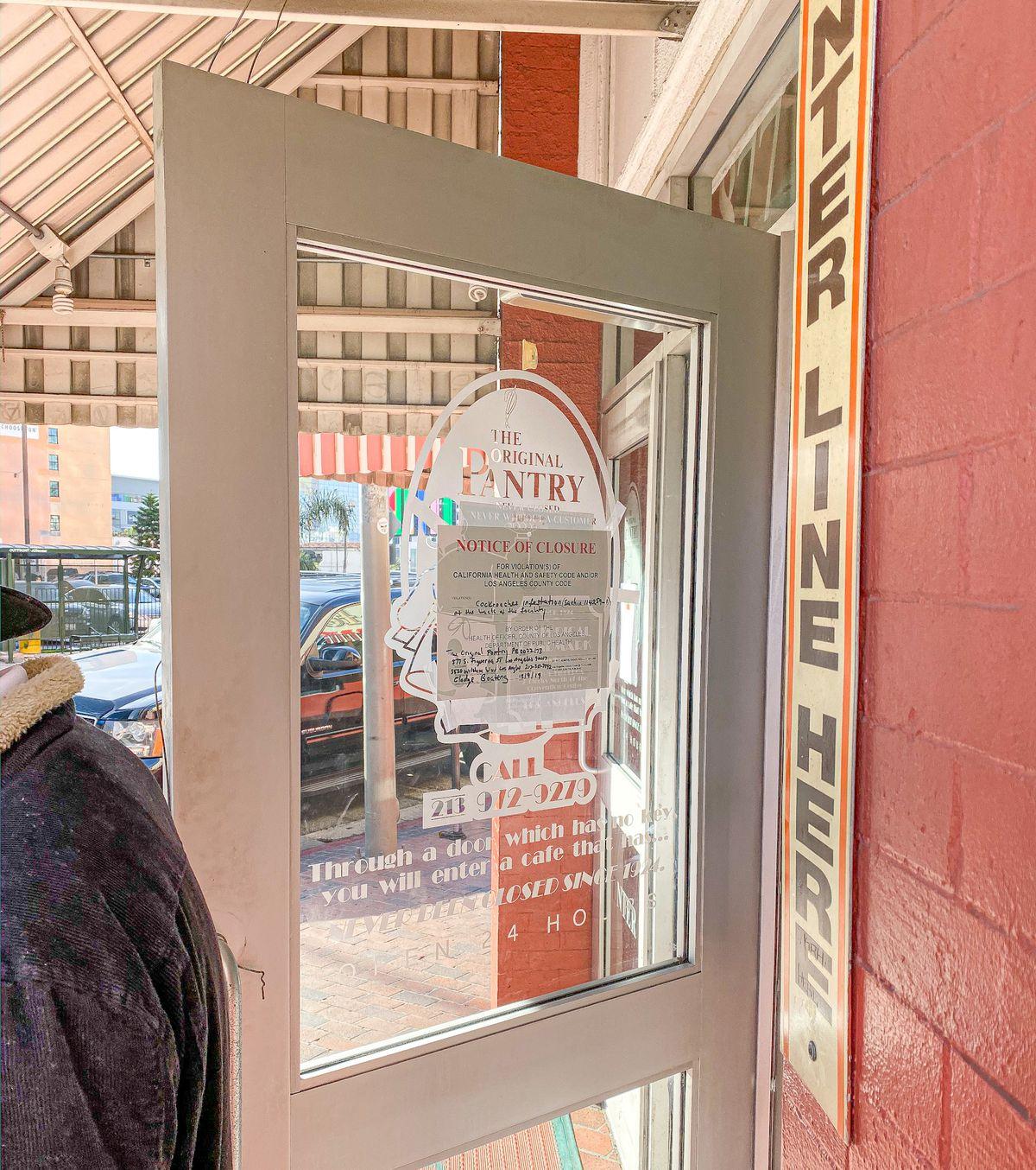A health department closure notice is tucked away on a door.