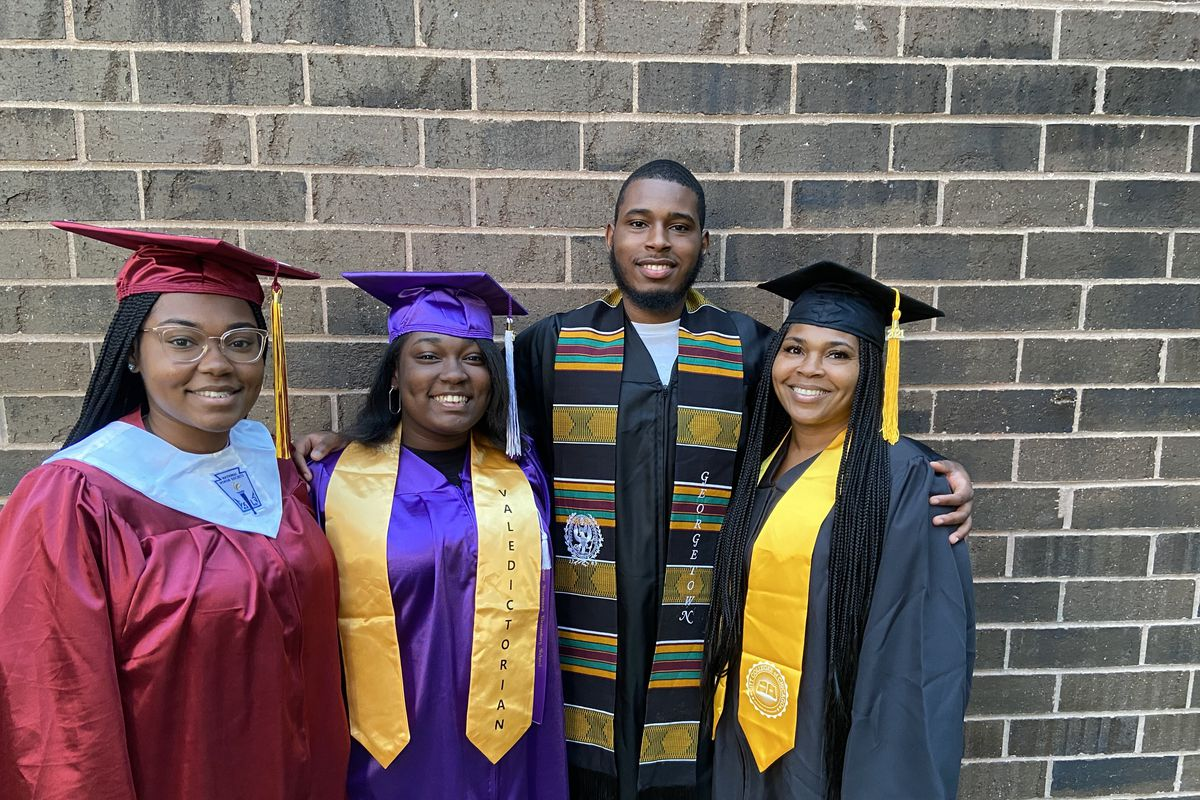 The entire Johnson family graduated this year. (l-r) Makaela graduated this month from Lindblom High School, headed to Tuskegee University. Mia also graduated this month, from Sherwood Elementary, as valedictorian, like her brother and sister before her. Malik graduated May 24 from Georgetown University, with a bachelor's in anthropology. And Alisa Perry Johnson, matriarch of this Englewood family, graduated May 23 from Richard J. Daley College, with an associate's in early childhood education.