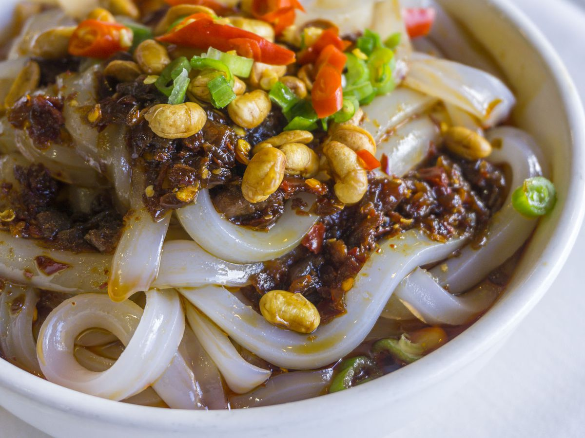 A closeup view of Chengdu Taste's mung bean jelly noodles with chili sauce.