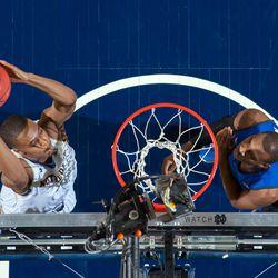 VJ Beachem slams home a dunk.