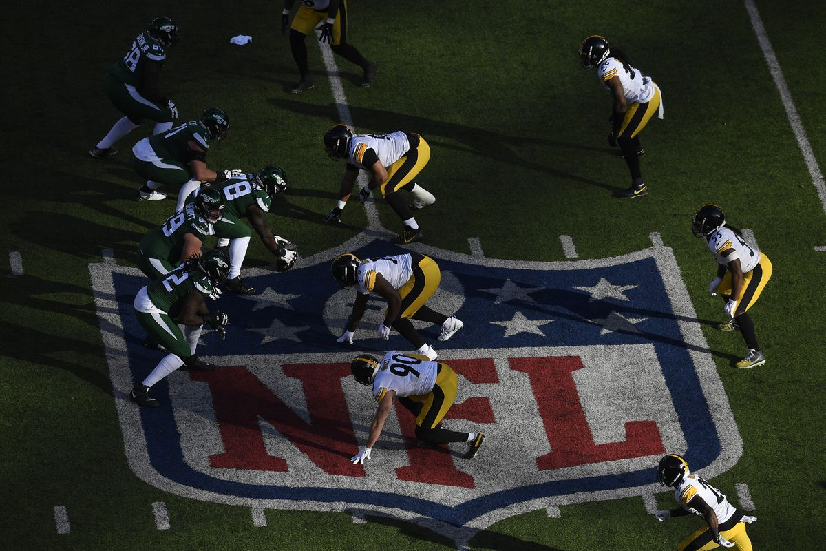 The New York Jets ready at the line of scrimmage over the NFL logo during the first half of the game against the Pittsburgh Steelers at MetLife Stadium on December 22, 2019 in East Rutherford, New Jersey.
