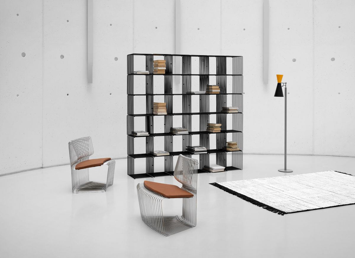 Two chairs next to shelving and lamp