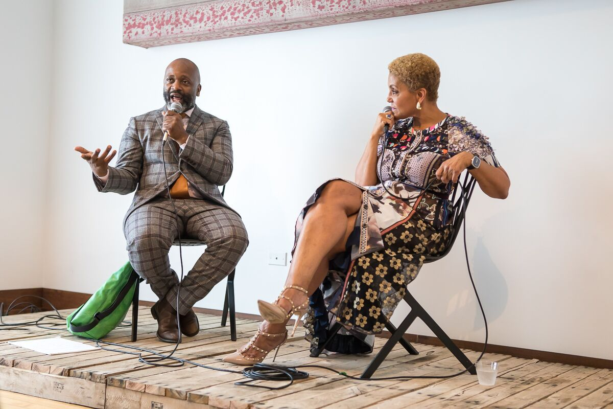 "Theaster Gates and Linda Johnson Rice speak at the June 28 opening of ""A Johnson Publishing Story"" at the Stony Island Arts Bank.   NANCY WON"