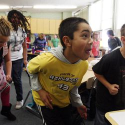 Daniel Berroteran, front center, and Jeff Pearce, front right, exercise in Nicole Carter's class at Tolman Elementary School in Bountiful, Monday, Nov. 26, 2012.