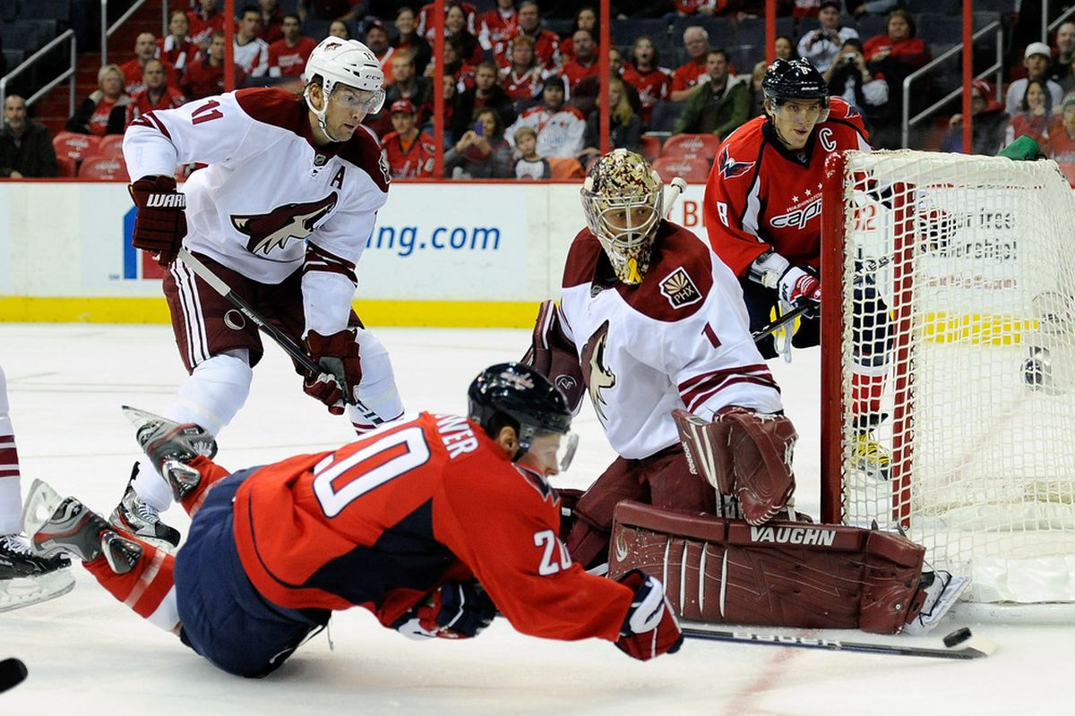 WASHINGTON, DC - NOVEMBER 21:  Jason LaBarbera #1 of the Phoenix Coyotes makes a save against Troy Brouwer #20 of the Washington Capitals at the Verizon Center on November 21, 2011 in Washington, DC.  (Photo by Greg Fiume/Getty Images)