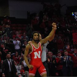 Nebraska's Chad Red Jr. gets his hand raised after winning by pinfall at 141-pounds against Michigan's Cole Mattin Friday at the Devaney Sports Center.