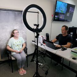 Eighth grader Cheyanne Fizer gets her photo taken as Parker Solum, Campus Photo Studio photographer, makes her an ID card during in-person orientation at Mountain Heights Academy, an online school based in West Jordan, on Tuesday, Aug. 24, 2021.