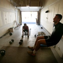 Kyle Collinsworth and his wife, Shea Collinsworth, do a short workout at their home in Provo on Wednesday, April 22, 2020.