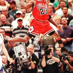 Chicago's Michael Jordan celebrates the Bulls' 87-86 defeat over the Utah Jazz in Game 6 of the NBA Finals in Salt Lake City, in this June 14, 1998 photo. The Bulls won their third-straight NBA title.