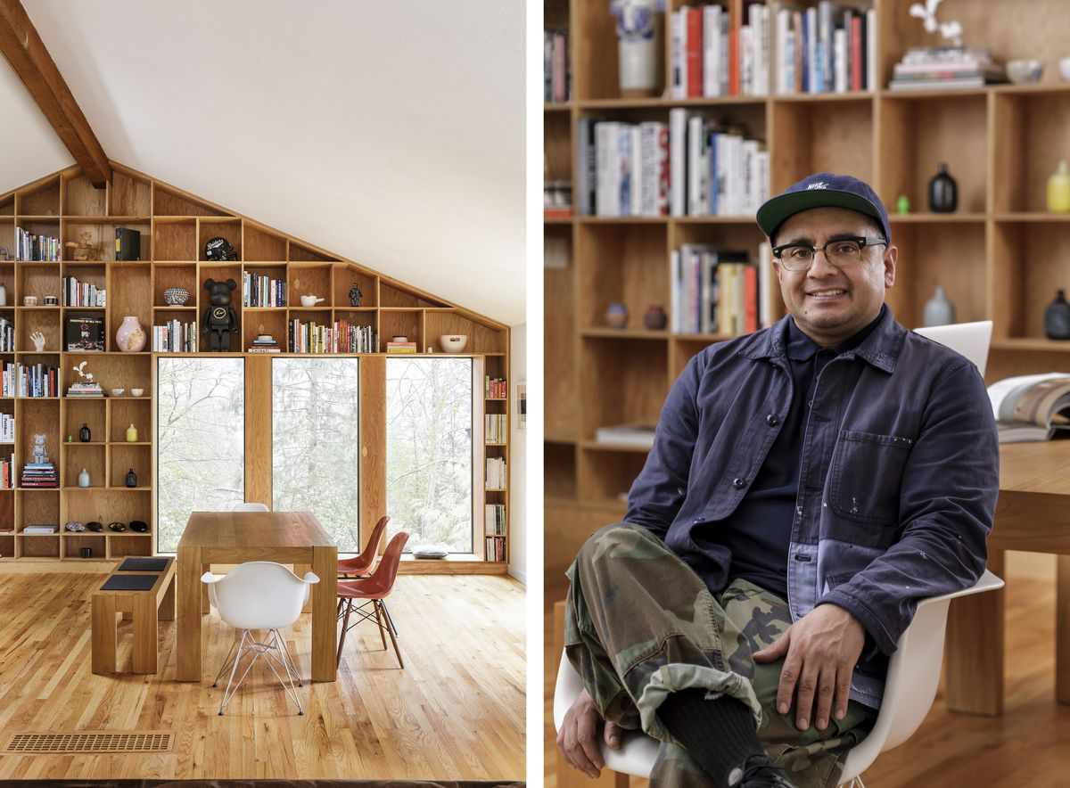 A dining room with floor-to-ceiling plywood shelves and a portrait of homeowner Jesse Levya.