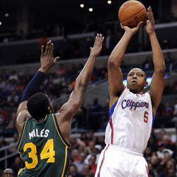 LOS ANGELES, CA - MARCH 31:  Caron Butler #5 of the Los Angeles Clippers scores on a jumper in front of C.J. Miles #34 of the Utah Jazz at Staples Center on March 31, 2012 in Los Angeles, California.  NOTE TO USER: User expressly acknowledges and agrees that, by downloading and or using this photograph, User is consenting to the terms and conditions of the Getty Images License Agreement.  (Photo by Harry How/Getty Images)