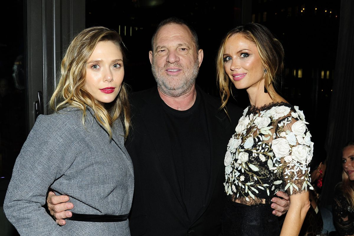 Harvey Weinstein with the actress Elizabeth Olsen, and his wife Georgina Chapman, August 2017 in New York.