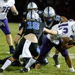 Tooele's Mateaki Helu tries to get past Stansbury's defense as they compete in a high school football gameat Stansbury High School in Stansbury Park on Friday, Sept. 17, 2021.